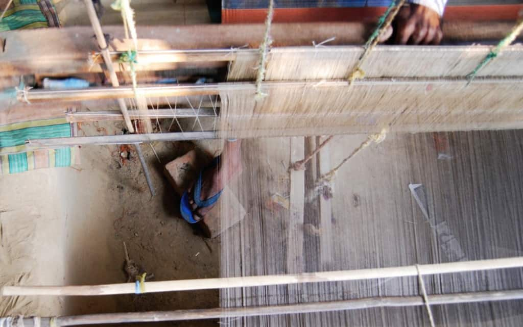 Amitava-mans-foot-through-working-loom