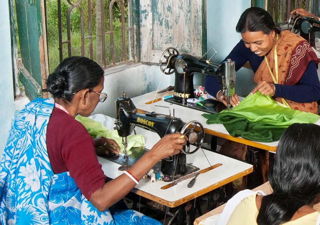 Women sewing at Kolaghat SEWS making garments for Sasha