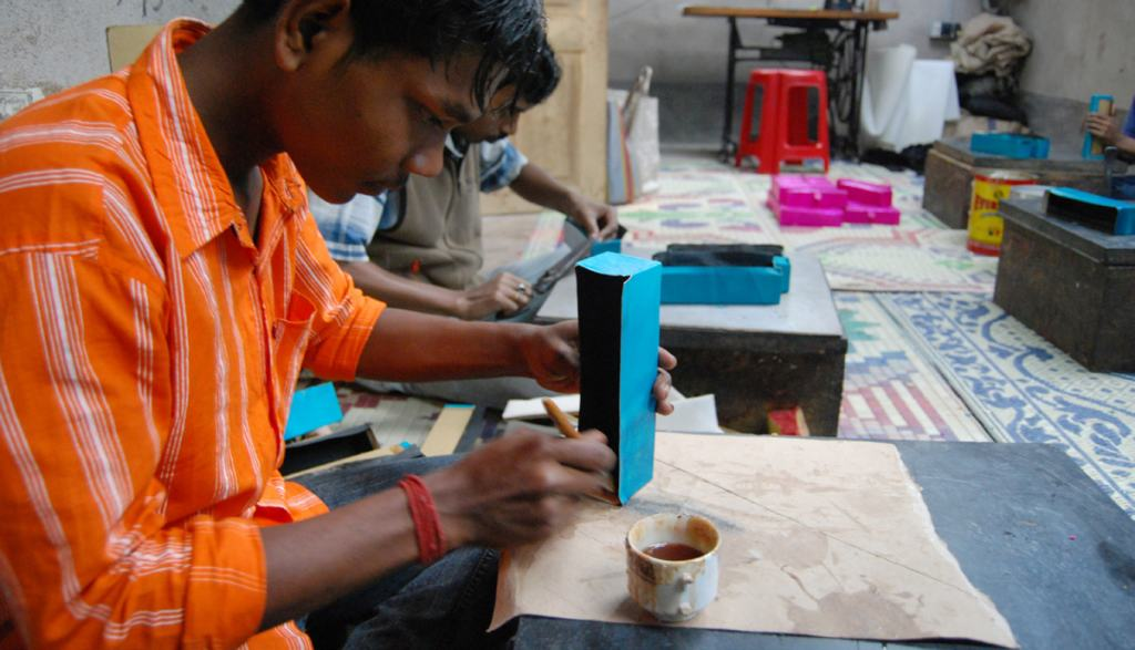 Assembling a leather product at Shanti Handicrafts