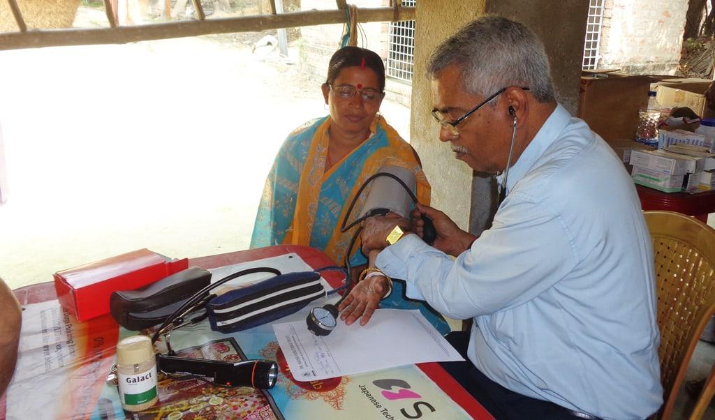 Woman getting a health check - Sasha organized health camp